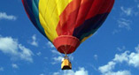 filled with hot air and soaring